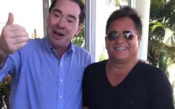 Desembargador Jaime Machado Junior (esq.) e o cantor Leonardo durante o vídeo / Reprodução